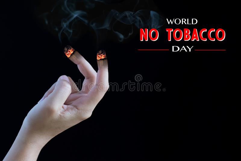 World No Tobacco Day, May 31. STOP Smoking. Retouch image of Close up woman hand holding cigarettes and fingers burning as cigarettes on black background royalty free stock photos