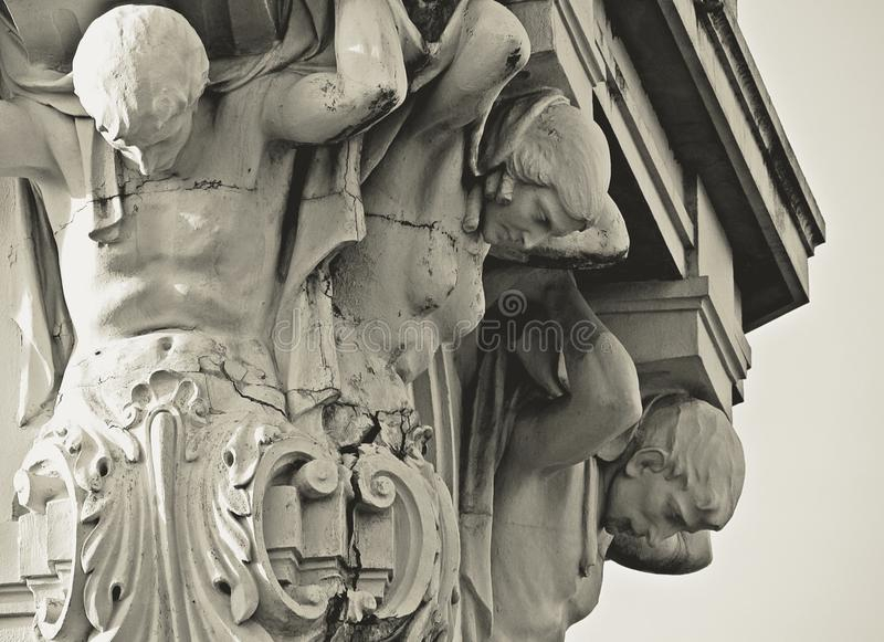 The world on ones shoulders. Sculptures of a monastery royalty free stock photo