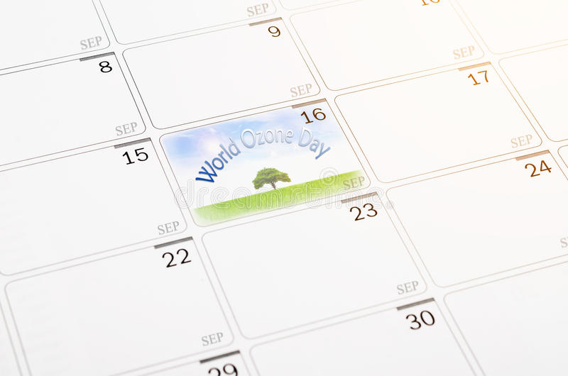 World Ozone Day concept. Big tree and green grass with blue sky on 16th September calendar page. World Ozone Day concept royalty free stock image
