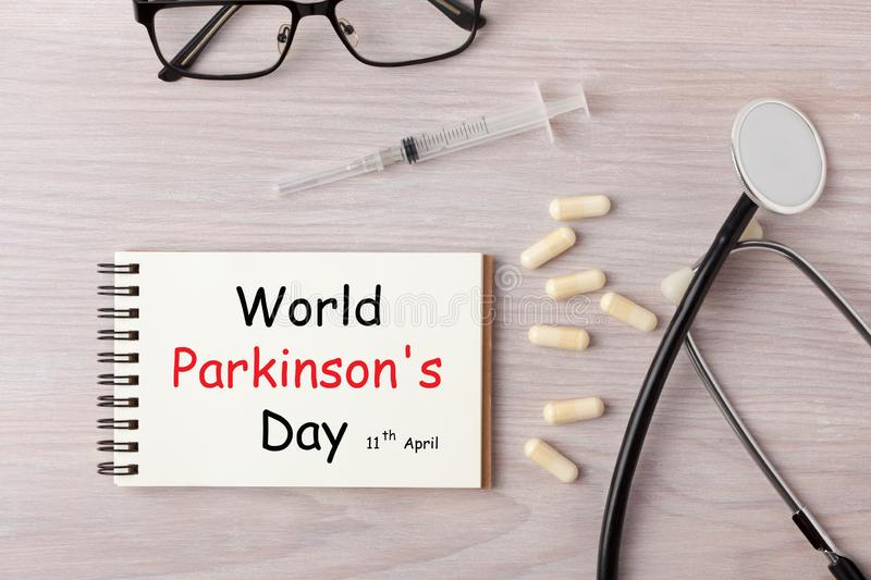 World Parkinson`s Day. Written on notebook with stethoscope, syringe and pills. Medical concept royalty free stock photo
