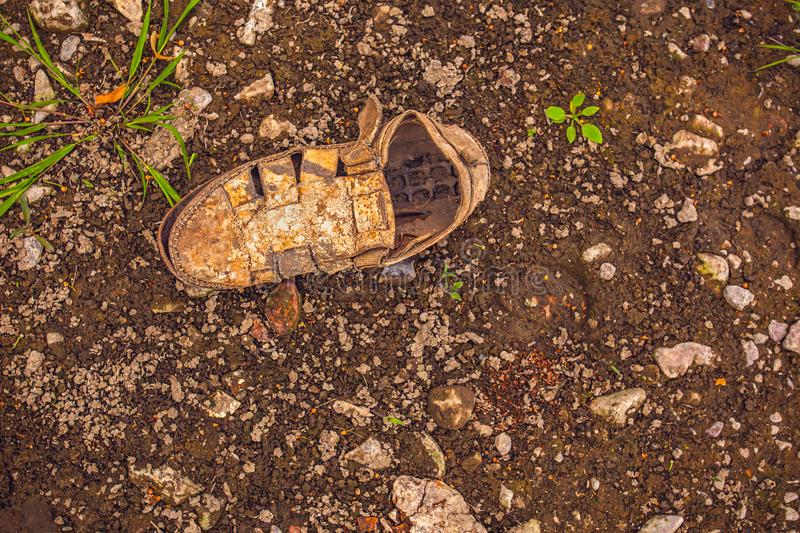 World problem with global warming, old shoe on dryed earth. The desert. It`s hot, the global shortage of water on the royalty free stock photography