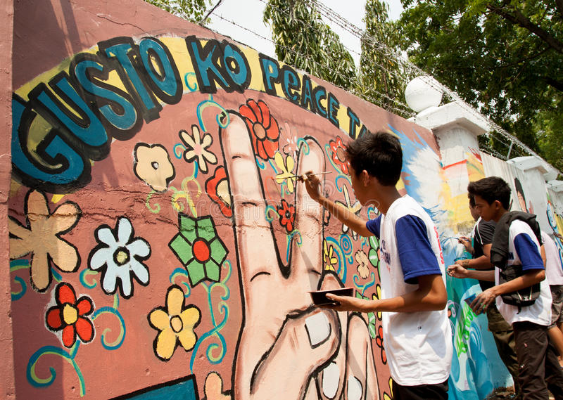 World record peace mural painting in Manila, Philippines. Quezon City, Philippines - June 1, 2013: An attempt to make 3,770 meters of peace mural along the major royalty free stock photography