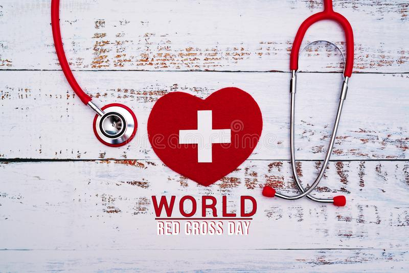 World Red Cross day. Red heart with Stethoscope on wooden table background stock illustration