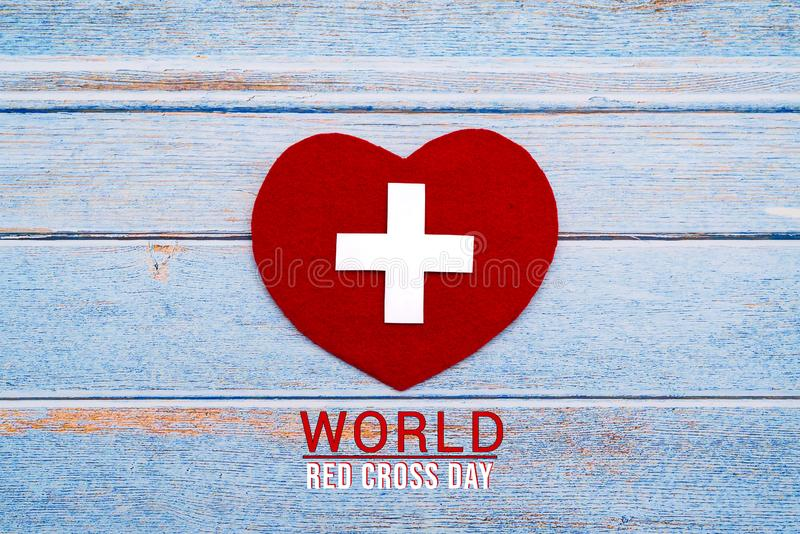 World Red Cross day. Red heart on wooden table background texture vector illustration