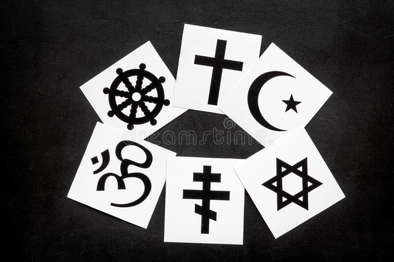 World religions concept. Christianity, Catholicism, Buddhism, Judaism, Islam symbols on black background top view.  stock image
