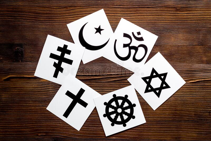 World religions concept. Christianity, Catholicism, Buddhism, Judaism, Islam symbols on wooden background top view.  royalty free stock photos