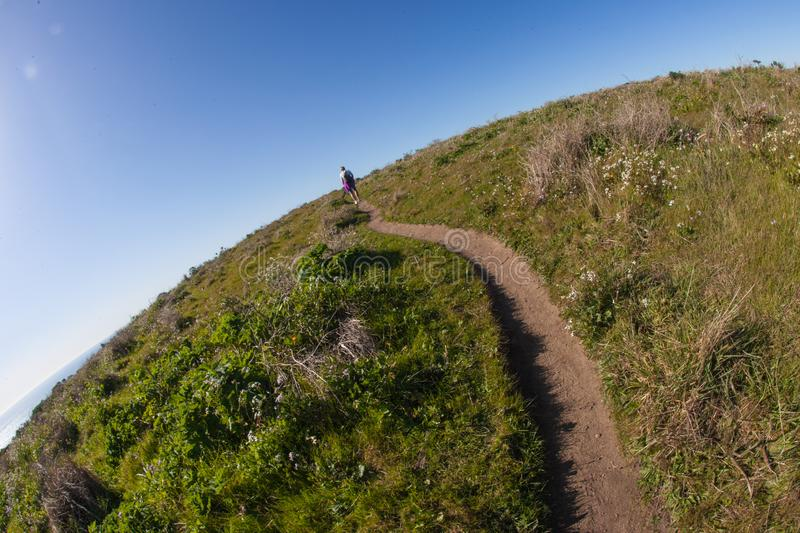The world is round hiking. Point Reyes, United States - March 03, 2012 : A truely special place where the San Andreas vault line cuts in the North american plate stock photography