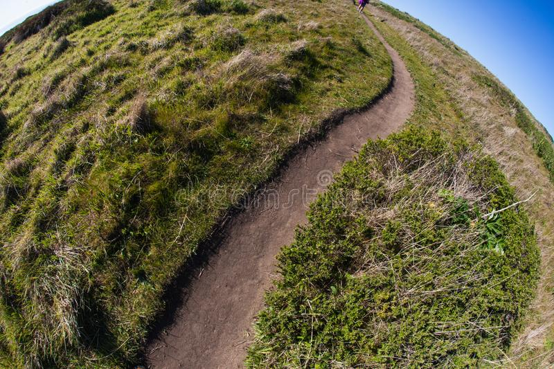 The world is round hiking trail nature plants. Point Reyes, United States - March 03, 2012 : A truely special place where the San Andreas vault line cuts in the royalty free stock photo