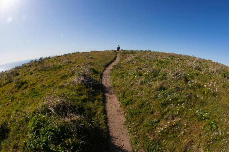 The world is round hiker hiking trail. Point Reyes, United States - March 03, 2012 : A truely special place where the San Andreas vault line cuts in the North stock photography