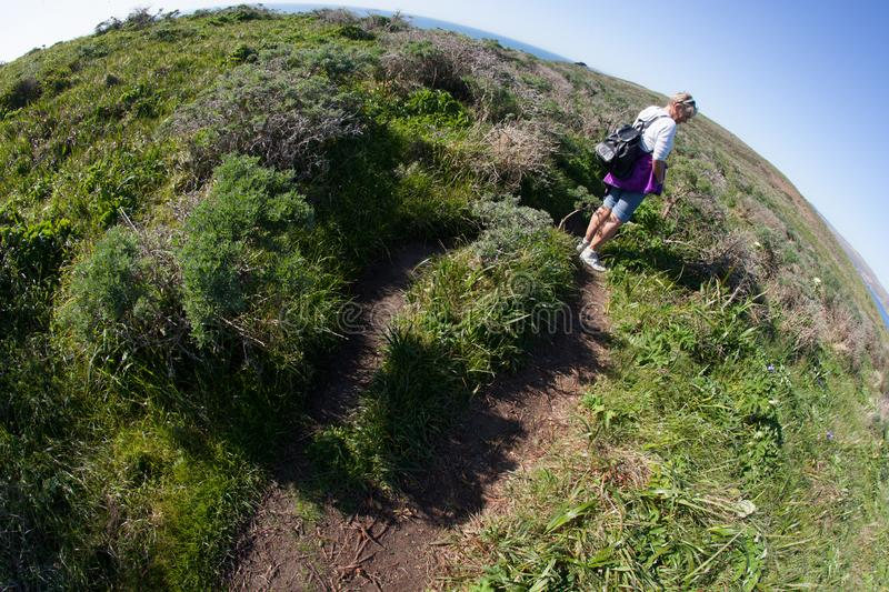 The world is round hiking trail. Point Reyes, United States - March 03, 2012 : A truely special place where the San Andreas vault line cuts in the North american royalty free stock photography