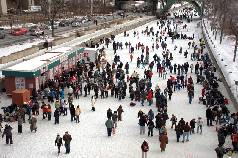 World's largest outdoor skating rink. People celebrate the Winterlude festival on the frozen Rideau Canal, the world's largest outdoor skating rink royalty free stock photography