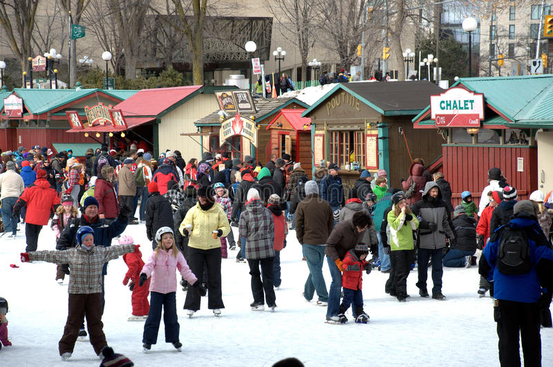 World's largest outdoor skating rink. People celebrate the Winterlude festival on the frozen Rideau Canal, the world's largest outdoor skating rink stock photos