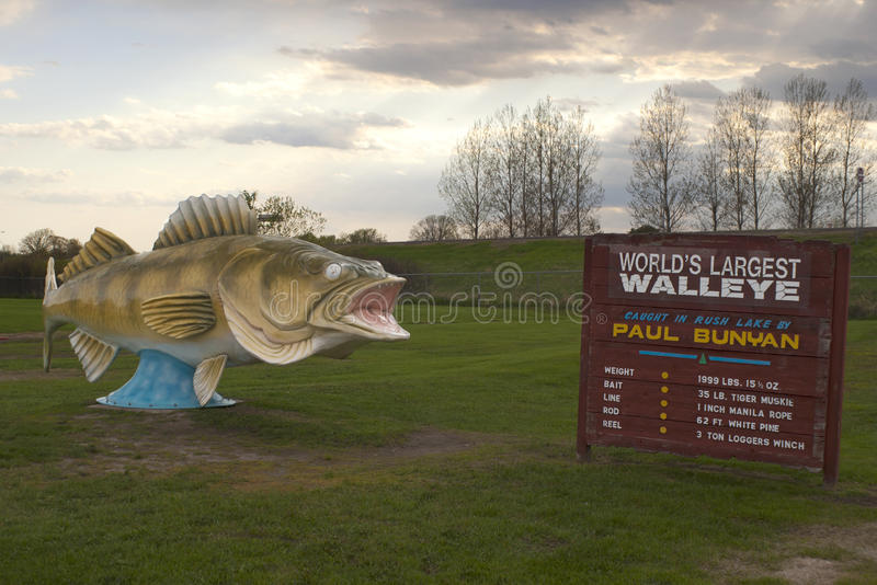 World's Largest Walleye. And information sign royalty free stock photo