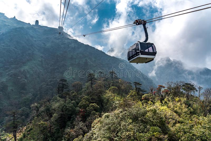 The world`s longest electric cable car go to Fansipan mountain peak the highest mountain in Indochina, Backdrop Beautiful view. Blue sky and cloud in Sapa stock photography