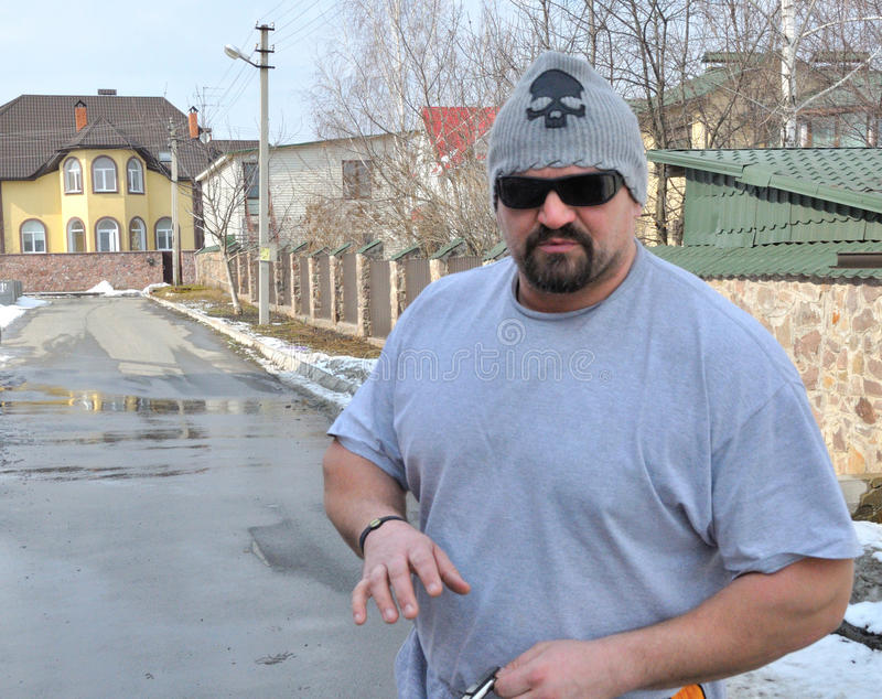 The World's Strongest Man Vasyl Virastuk. Walks near own house on March 20, 2013 in Kiev, Ukraine royalty free stock photos