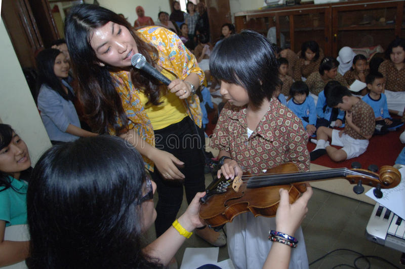 WORLD SIGHT DAY 2013. Members of Ashira band teaches music to students who are blind ELEMENTARY SCHOOL children's Education Foundation Blind LB (YPAB) Surabaya royalty free stock photo