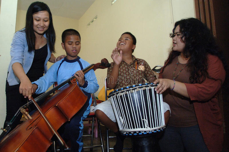 WORLD SIGHT DAY 2013. Members of Ashira band teaches music to students who are blind ELEMENTARY SCHOOL children's Education Foundation Blind LB (YPAB) Surabaya stock images
