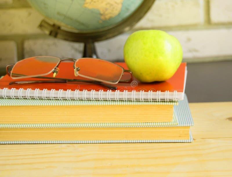 World teacher's Day at school. Still life with books, globe, Apple, glasses, sunlight. World teacher Day at school. Still life with books, globe, Apple royalty free stock image
