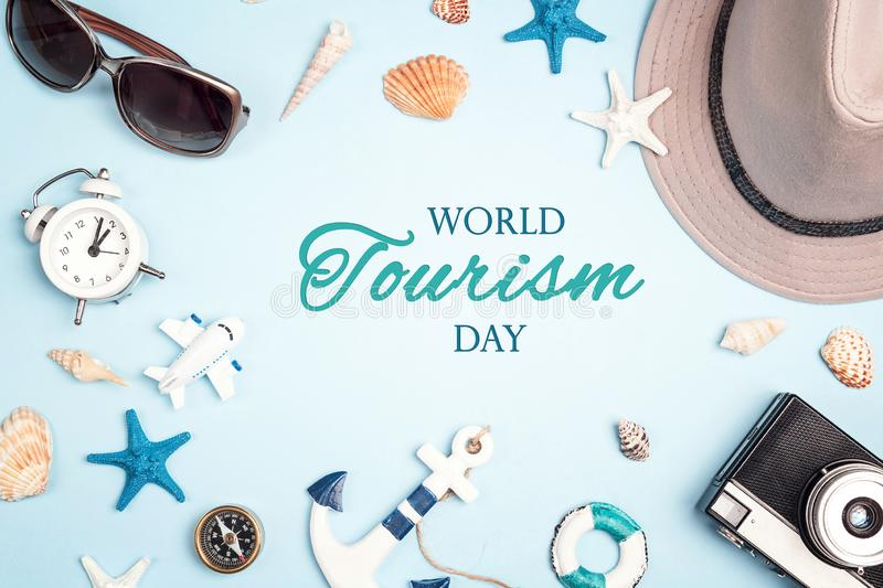 World tourism day background. Flat lay travel concept with vacation accessories royalty free stock photos