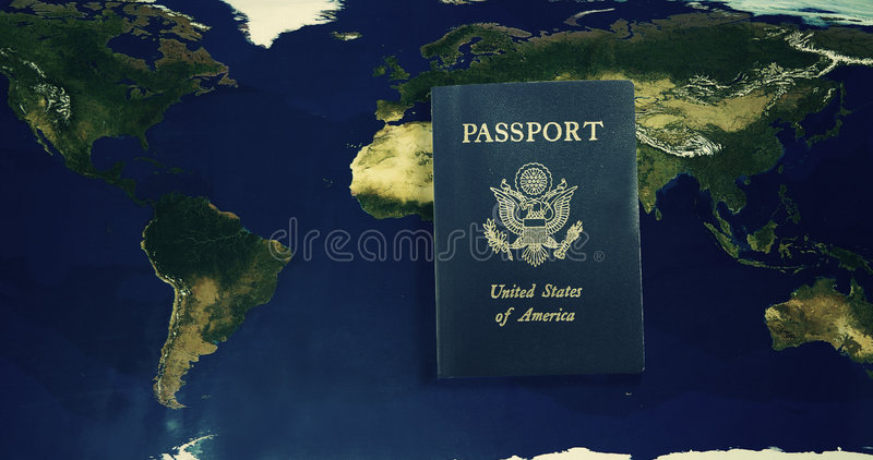World travel. U.S. Passport and over a world map royalty free stock image