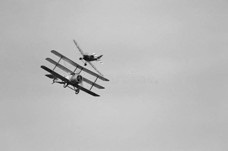 World War 1 Dogfight. World War One Dogfight between a british triplane and a German monoplane. Black & white photo royalty free stock images