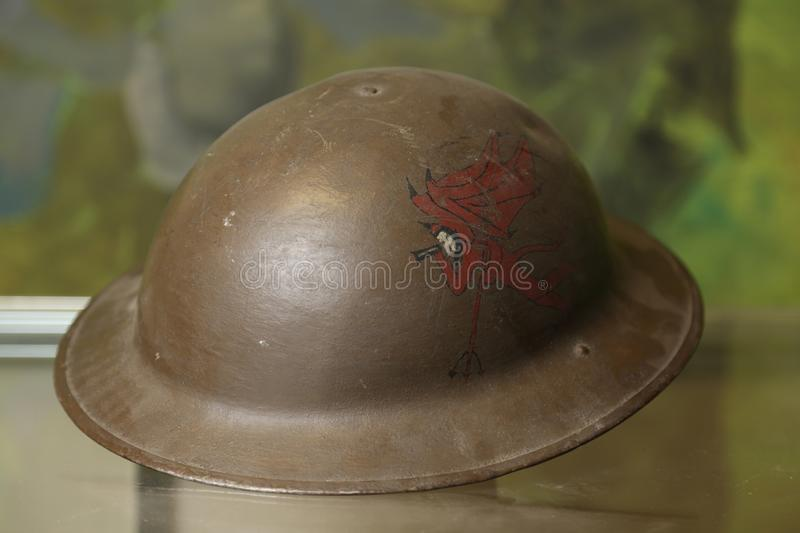 World War I uniform. World War I Army helmet featuring painted eblem of a red devil with wings stock photography