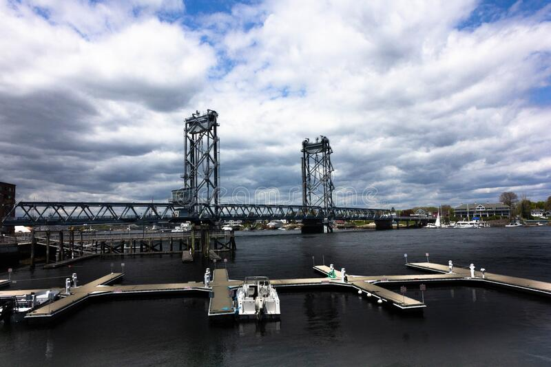 The Memorial Lift Bridge Portsmouth, N.H. With Marina in Foreground. The World War I Memorial Bridge is a vertical-lift bridge that carries U.S. Route 1 across stock photos
