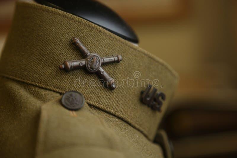 World War I uniform. Close up of artillary collar pin on a World War I Army uniform stock photo
