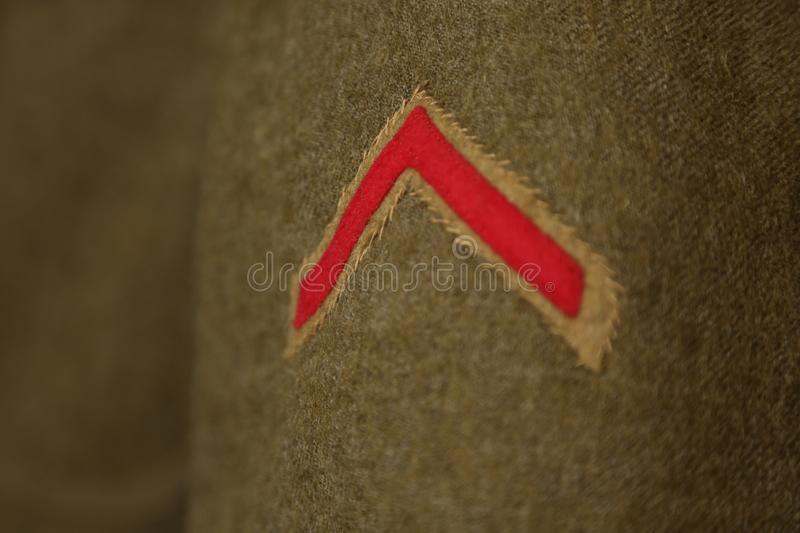 World War I uniform. Close up of discharge chevron on the sleeve of a U.S. Army uniform from World War I stock photos