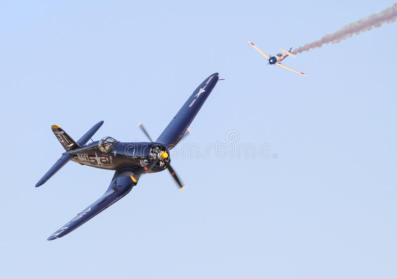World War II Aerial Dogfight. A Japenese Zero fighter plane pursues a U.S. Vought F4U Corsair fighter in a recreation of a World War II dogfight in the Pacific royalty free stock photos