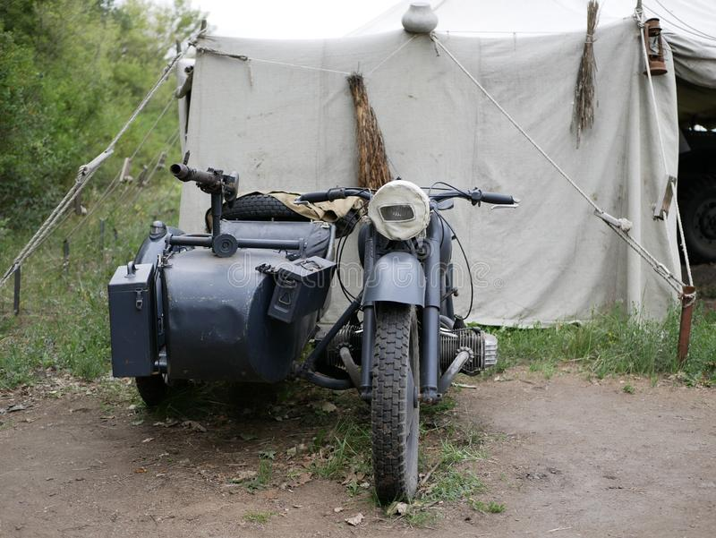 World war II motorcycle with sidecar and mounted ammunition boxes and mg-42 machine gun. German military motorcycle painted in dar royalty free stock image