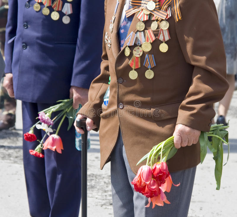 World War II veterans. With flowers. 9th May stock photography
