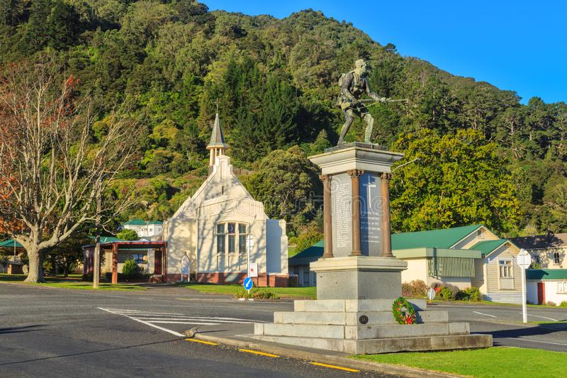 World War 1 memorial and old church, Te Aroha, New Zealand. Te Aroha`s war memorial statue of a soldier with a fixed bayonet, erected 1923, with St. Mark`s royalty free stock photo