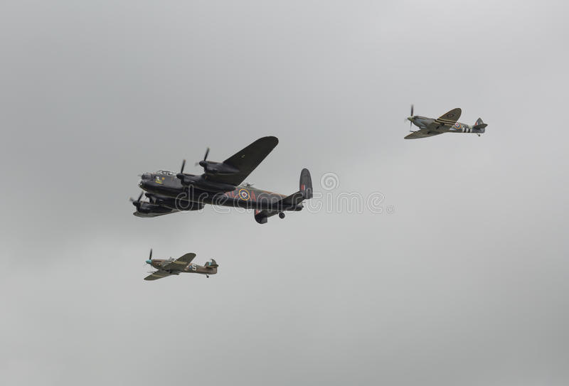 World War 2 planes. Lancaster Spitfire Hurricane flying together royalty free stock photography