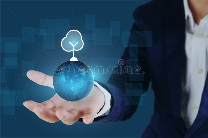 World water day concept: Business man hands holding earth globe and tree icon.Elements of this image furnished by NASA royalty free stock images
