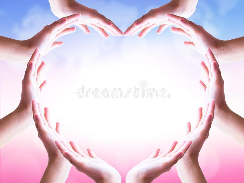International Day of Friendship concept: hands in shape of heart on blurred  background royalty free stock photography