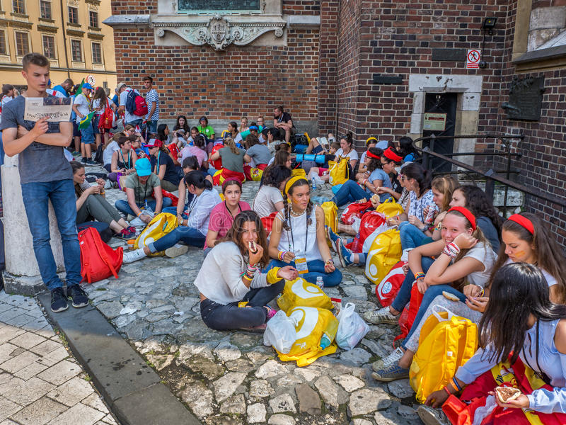 World Youth Day 2016. Pilgrims resting in the shadow of the church stock image