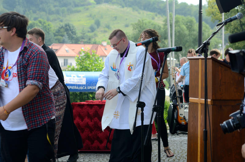 World Youth Day 2016 in Trzebnica. TRZEBNICA, POLAND - JULY 25: World Youth Day, dancing priest in front oft St. Jadwiga Sanctuary on 25th July 2016 in Trzebnica royalty free stock images