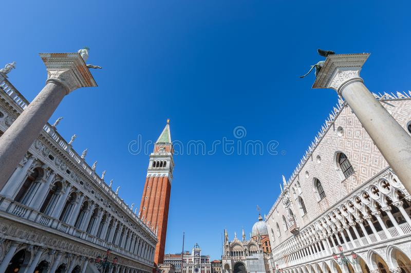 Worlds most beautiful square San Marco Piazza San Marco. View of the famous columns, Doge`s Palace Palazzo Ducale, and St. royalty free stock image