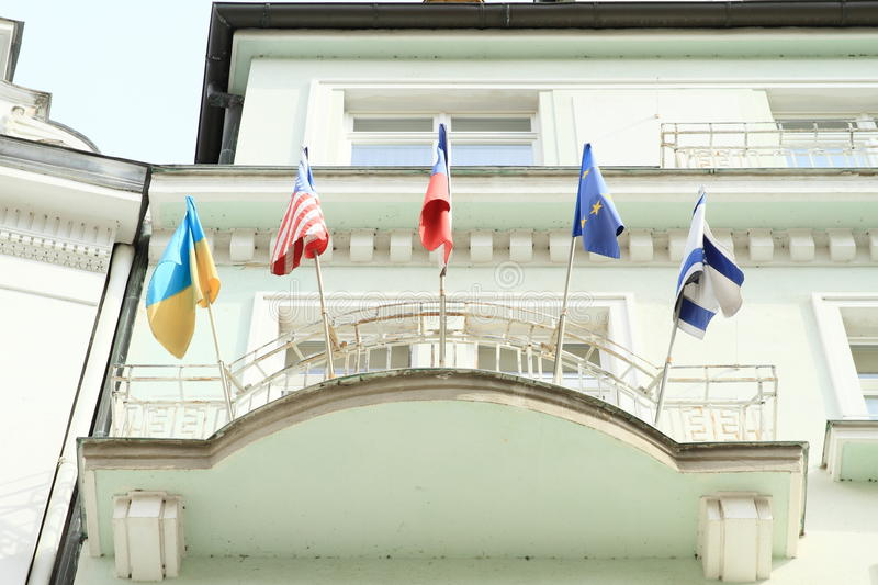 Worldwide flags. Flags from Czech Republic, USA, Ukraine, Eurpean Union and Israel) on bacony of green building in Karlovy Vary (Czech Republic royalty free stock images
