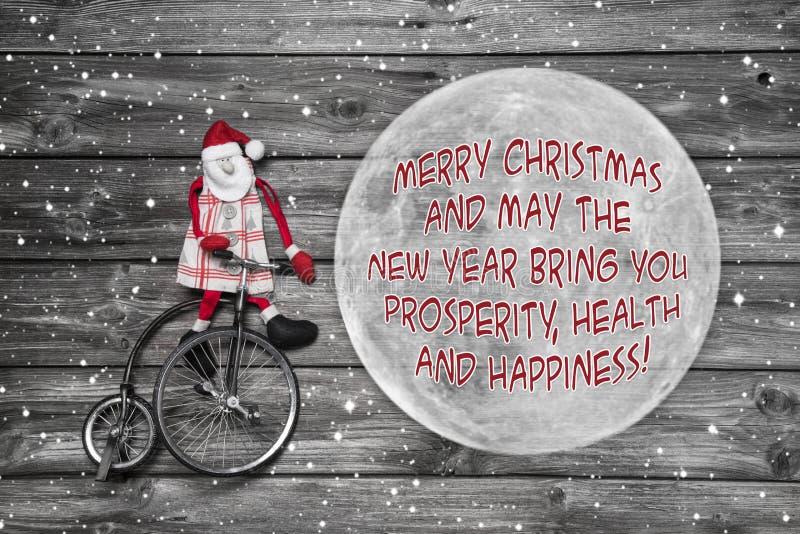 Worlwide-Weihnachtsgrüße auf der Kugel - Karte mit Sankt und stockbild