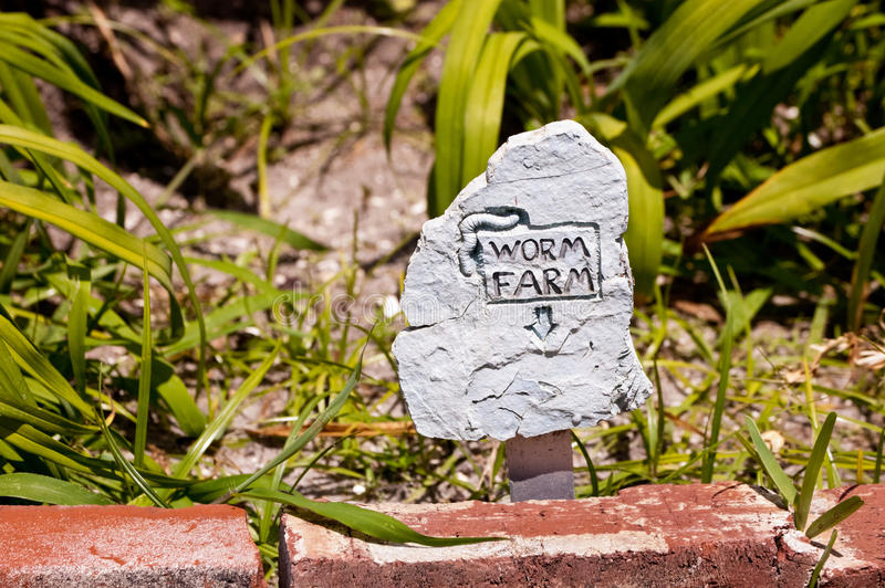 Worm farm sign. A sign for a worm farm in the garden stock photo