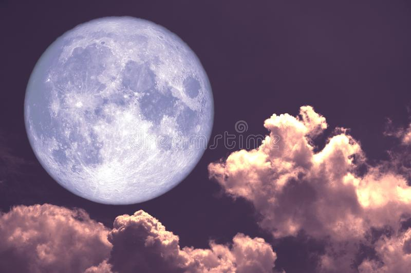 Worm moon back on silhouette heap cloud on sunset sky. Elements of this image furnished by NASA royalty free stock image