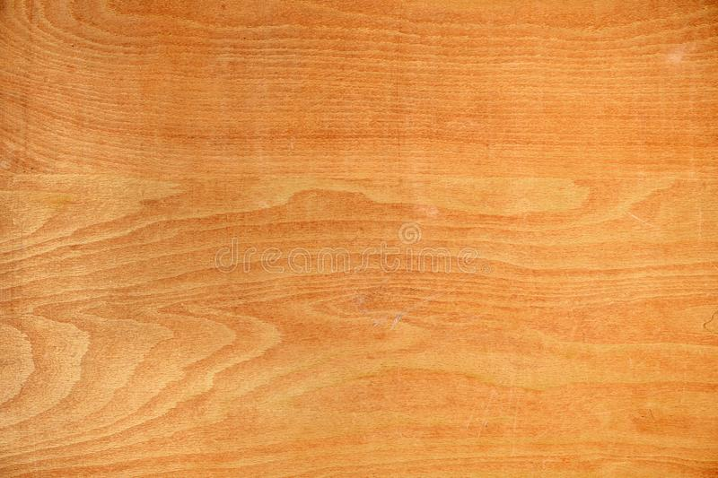 Worm plywood surface texture as background. Top view royalty free stock photography