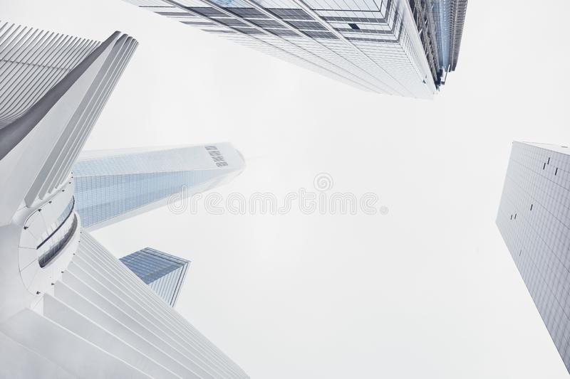 Worm`s-eye view of tall modern white business skyscraper buildings during the day stock photo
