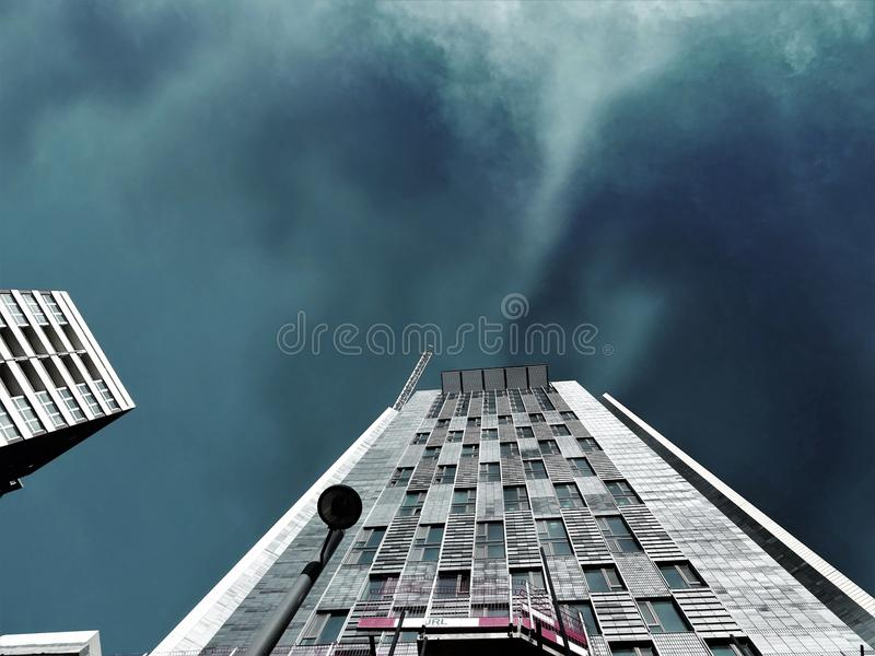 Worms Eye-view Photography of White High-rise Building during Storm Weather royalty free stock image