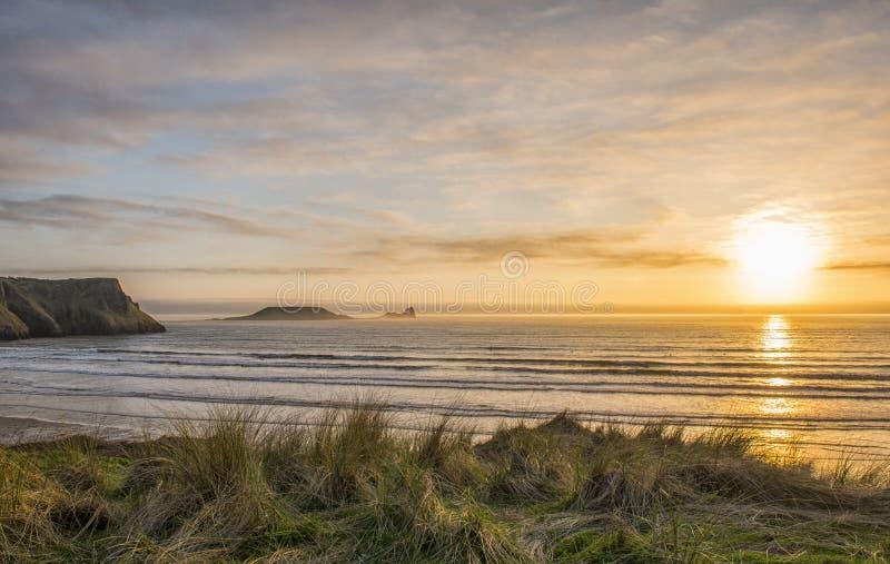 Wormshead Rhossili in Swansea, Zuid-Wales bij zonsondergang stock fotografie