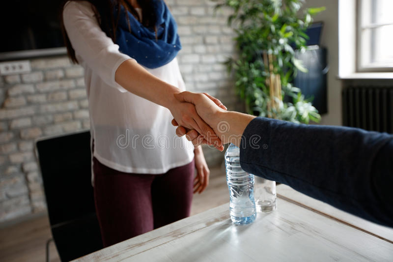 Wormy handshake as congratulation. For success in business royalty free stock photos