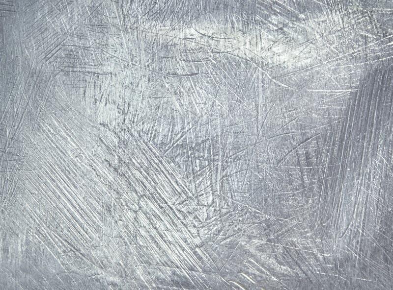 Worn металлопластинчатая стальная предпосылка foil серебр стоковая фотография