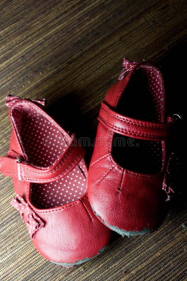 Worn baby girl shoes royalty free stock images